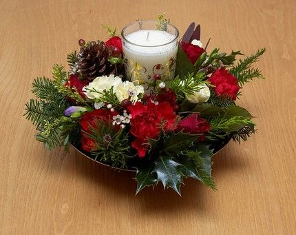 This Christmas Centerpiece Uses A Floral Ring With Fresh Flowers Delicately Arranged Christmas Centerpieces Christmas Flower Arrangements Christmas Planters