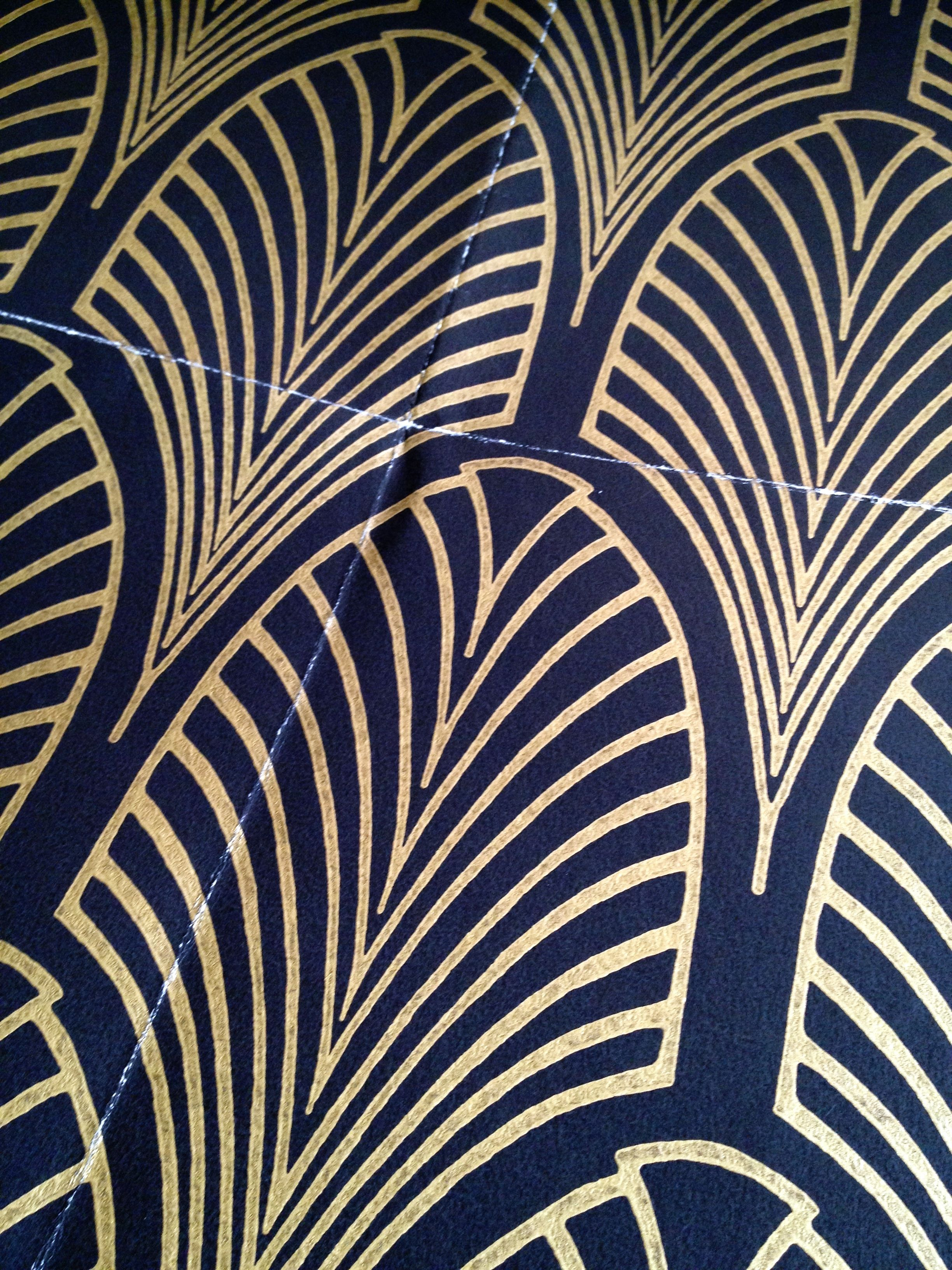 Black and gold Art Deco wallpaper from Cole & Son. Of