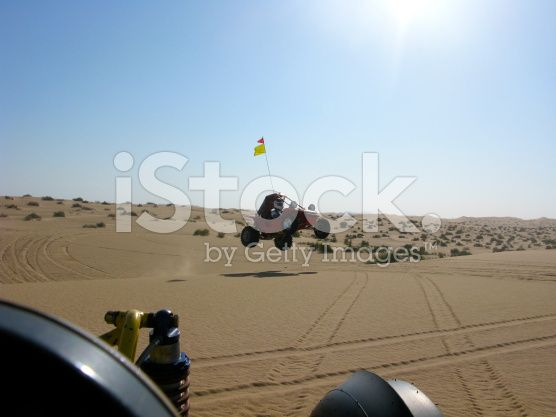 iStock - BUY ME! - Off Road Vehicle Jumping in Glamis royalty-free stock photo