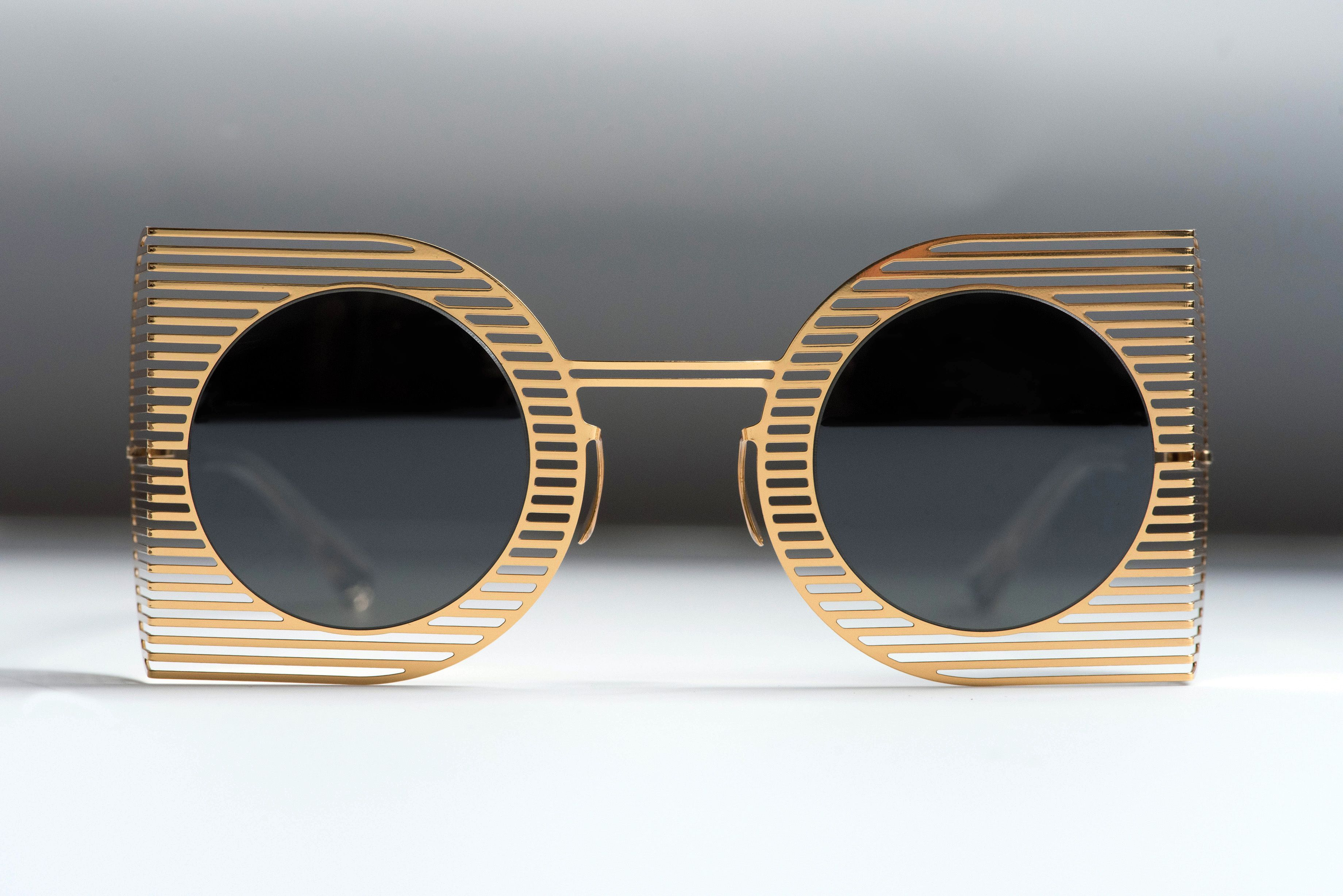 MYKITA STUDIO 1.3 | Sunglasses with a paper-thin steel frame front that casts shutter-like shadows on the face for a film noir effect. mykita.com/mykita-studio/sun-studio1-3