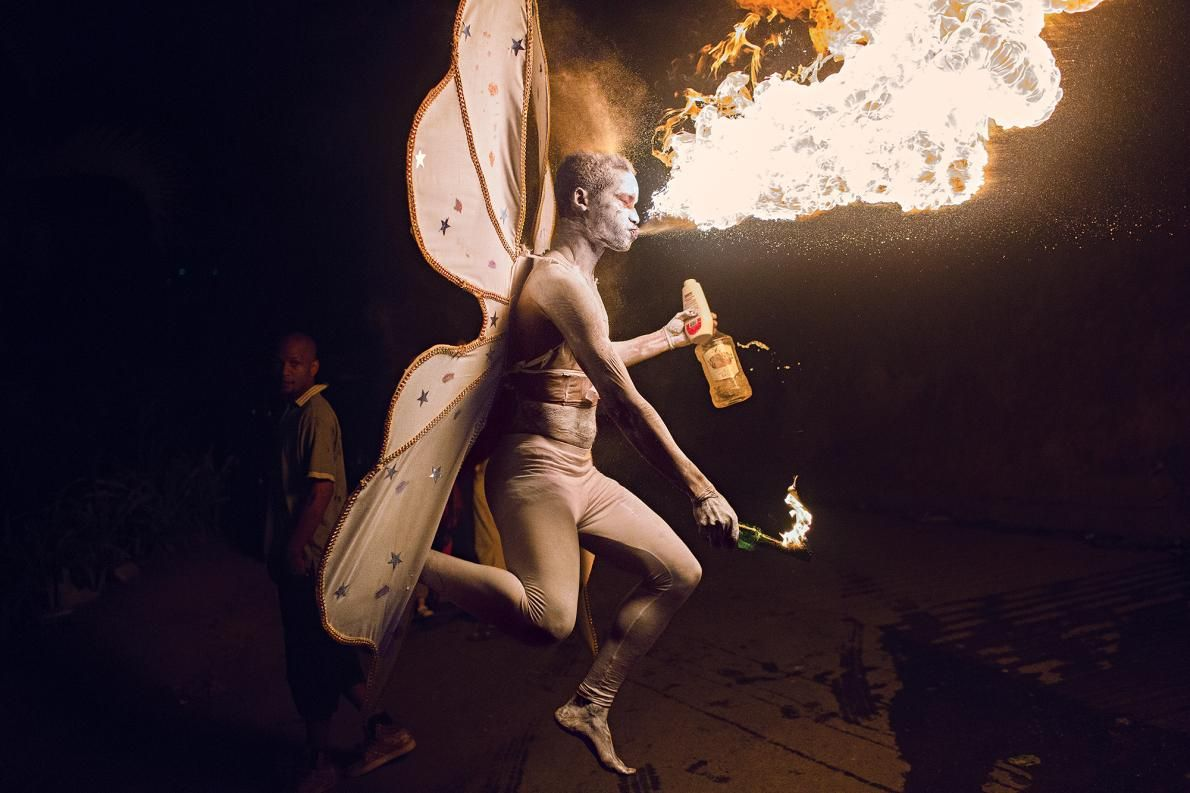 """Picture of a fire-breathing winged """"devil"""" character exhaling flames for…"""