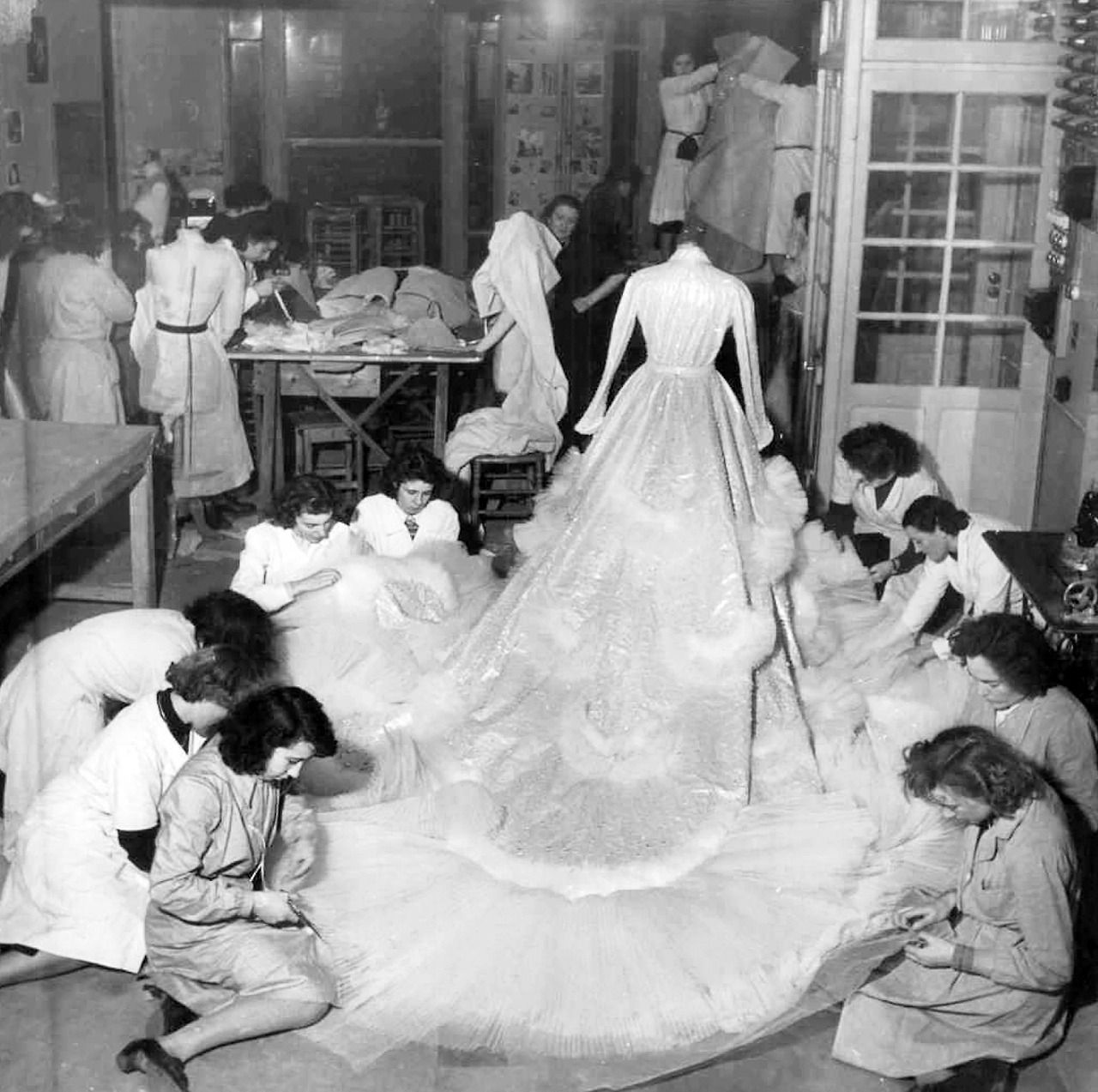 Christian Dior Wedding Gowns: Seamstresses At Work On The Wedding Dress For Princess
