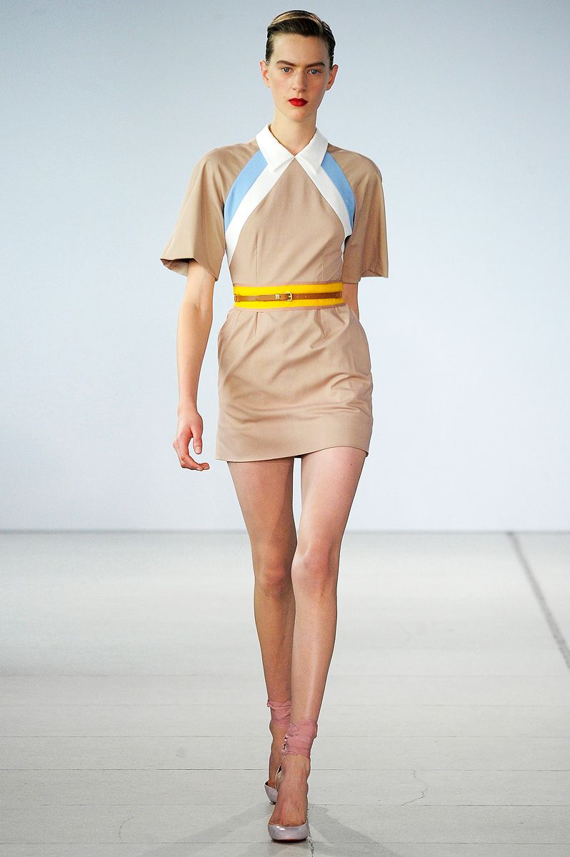 Colorblocking & inserts against a beige skin palette emphasize a small waist than draw attention to the face. jonathan saunders - pop of yellow neon is also very on trend.