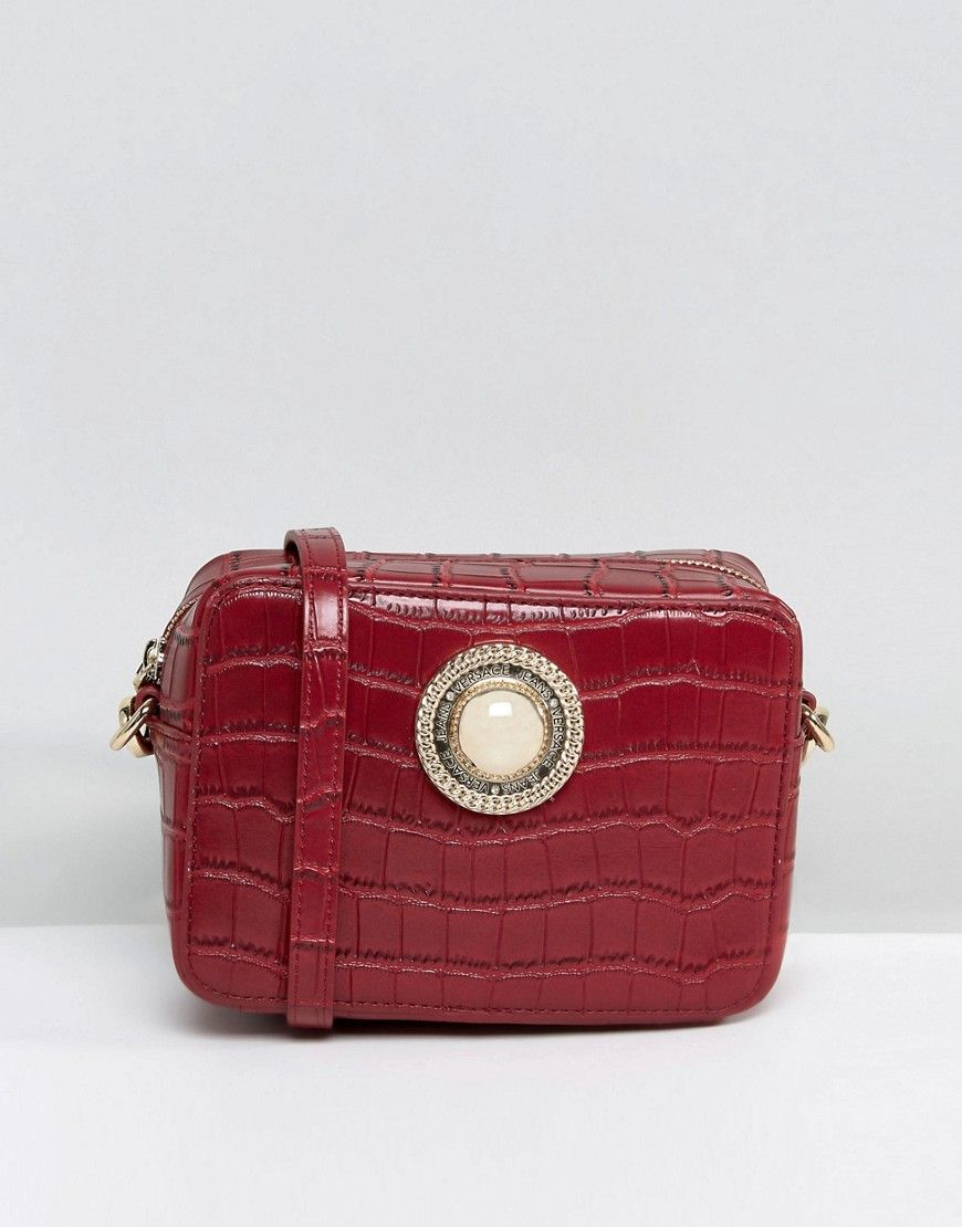 VERSACE JEANS SMALL CROC CROSS BODY WITH GOLD BUTTON DETAIL - RED.  versace   bags  shoulder bags  animal print  denim  metallic   0c817910bd8c1