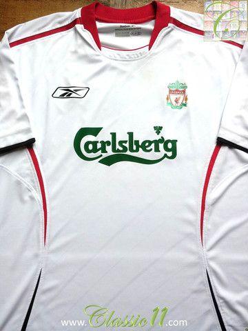 09b96f218 Relive Liverpool s 2005 2006 season with this vintage Reebok away football  shirt.