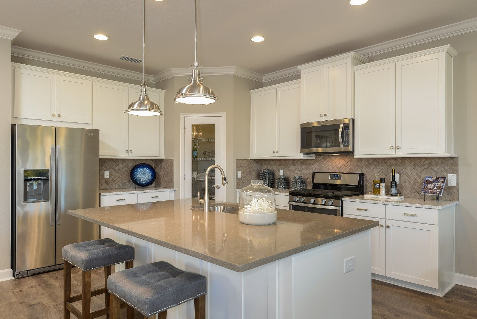 The gourmet kitchen of the  Sandpiper II  by CalAtlantic Homes includes  sleek appliances. The gourmet kitchen of the  Sandpiper II  by CalAtlantic Homes