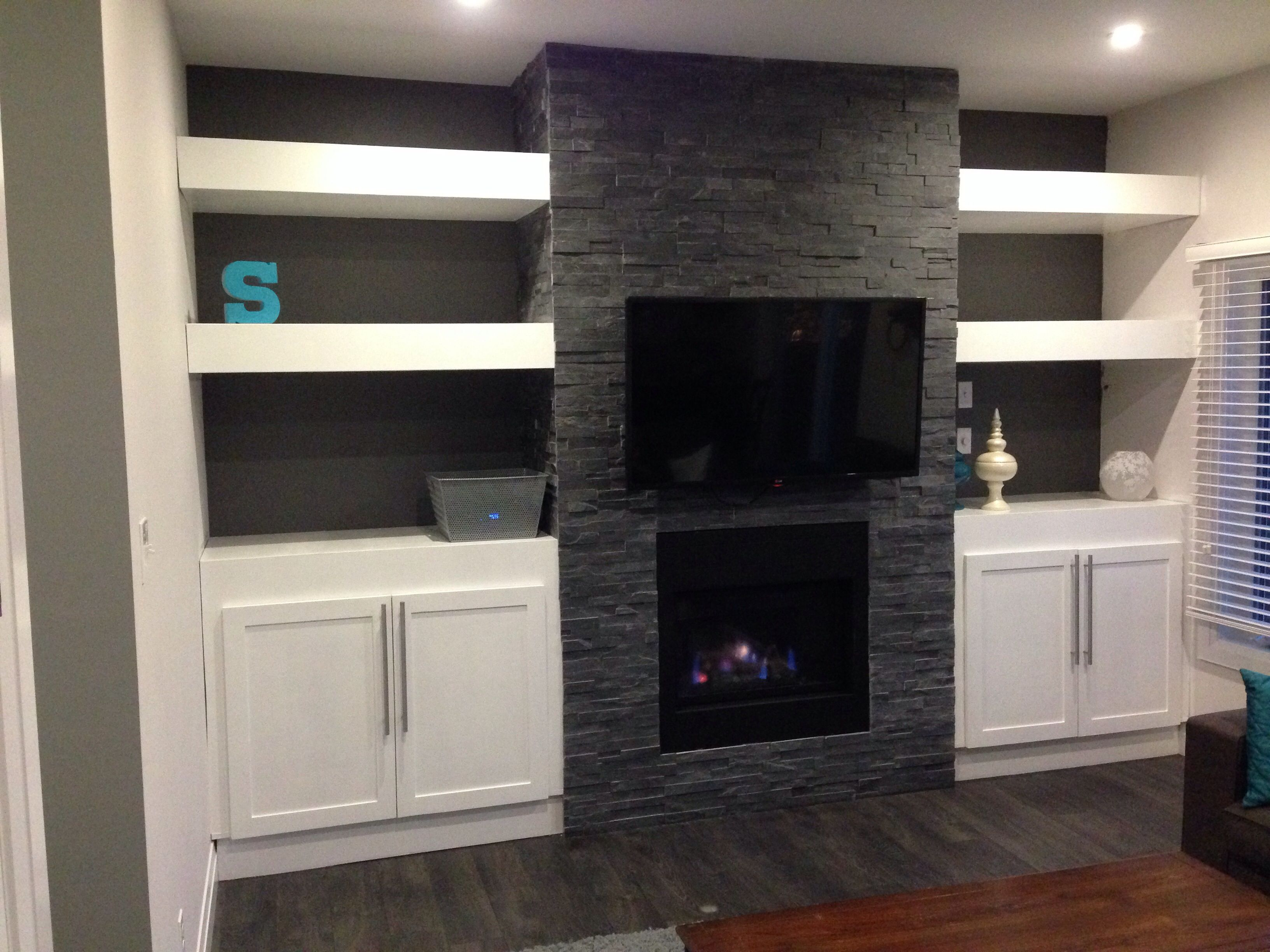 My diy stone fireplace with built in cabinets and floating for Diy built in shelves