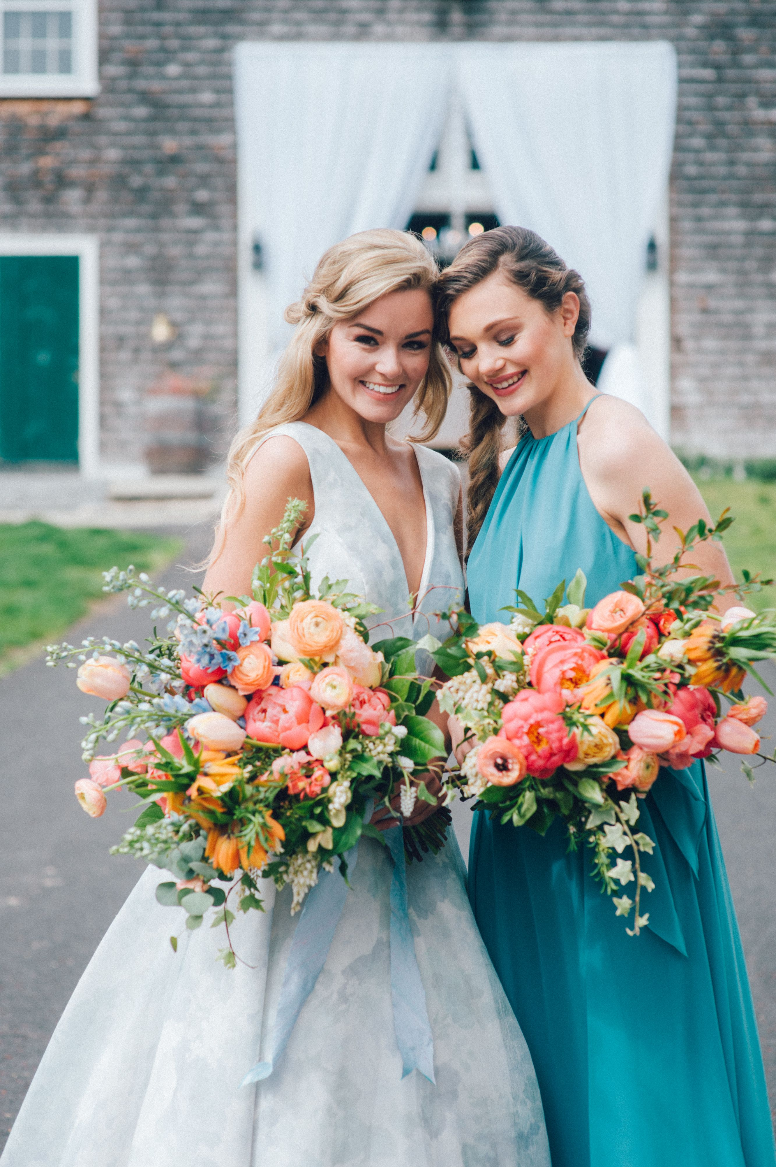 A painted blue floral wedding gown adds a touch of whimsy