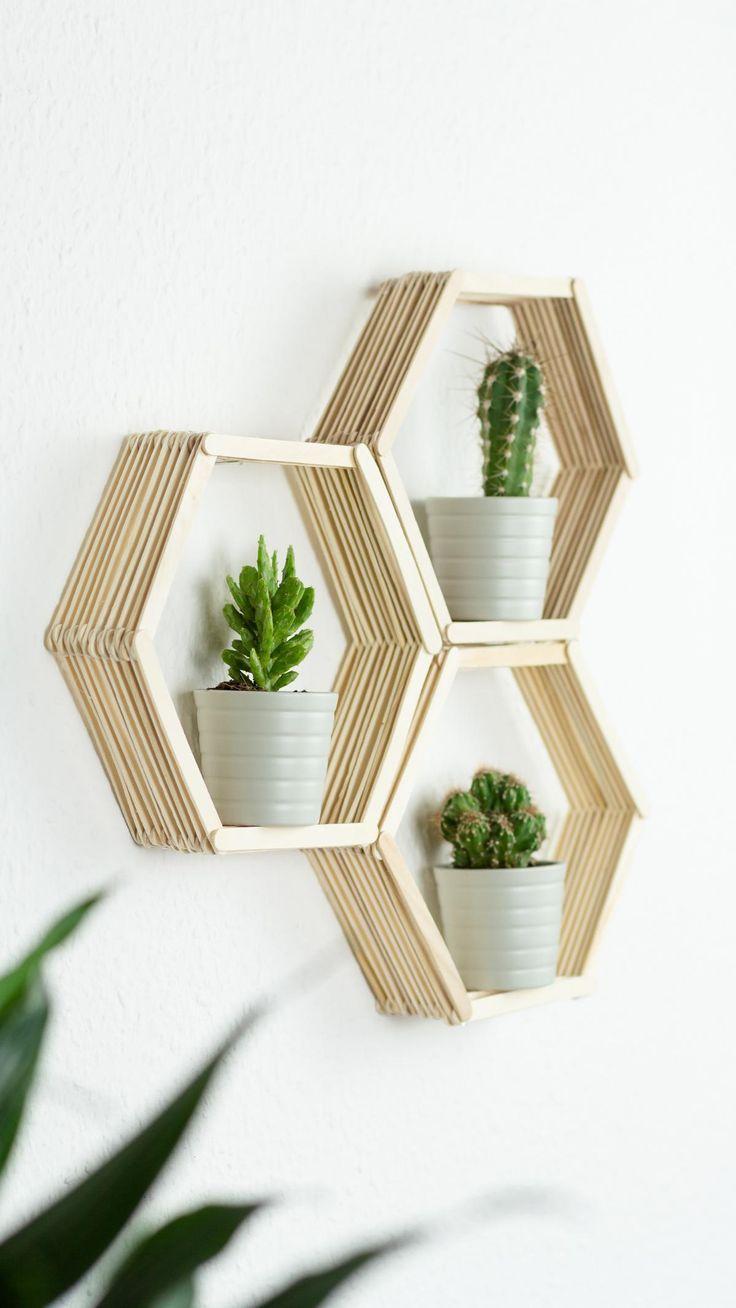 Make DIY honeycomb wall shelf from ice cream sticks