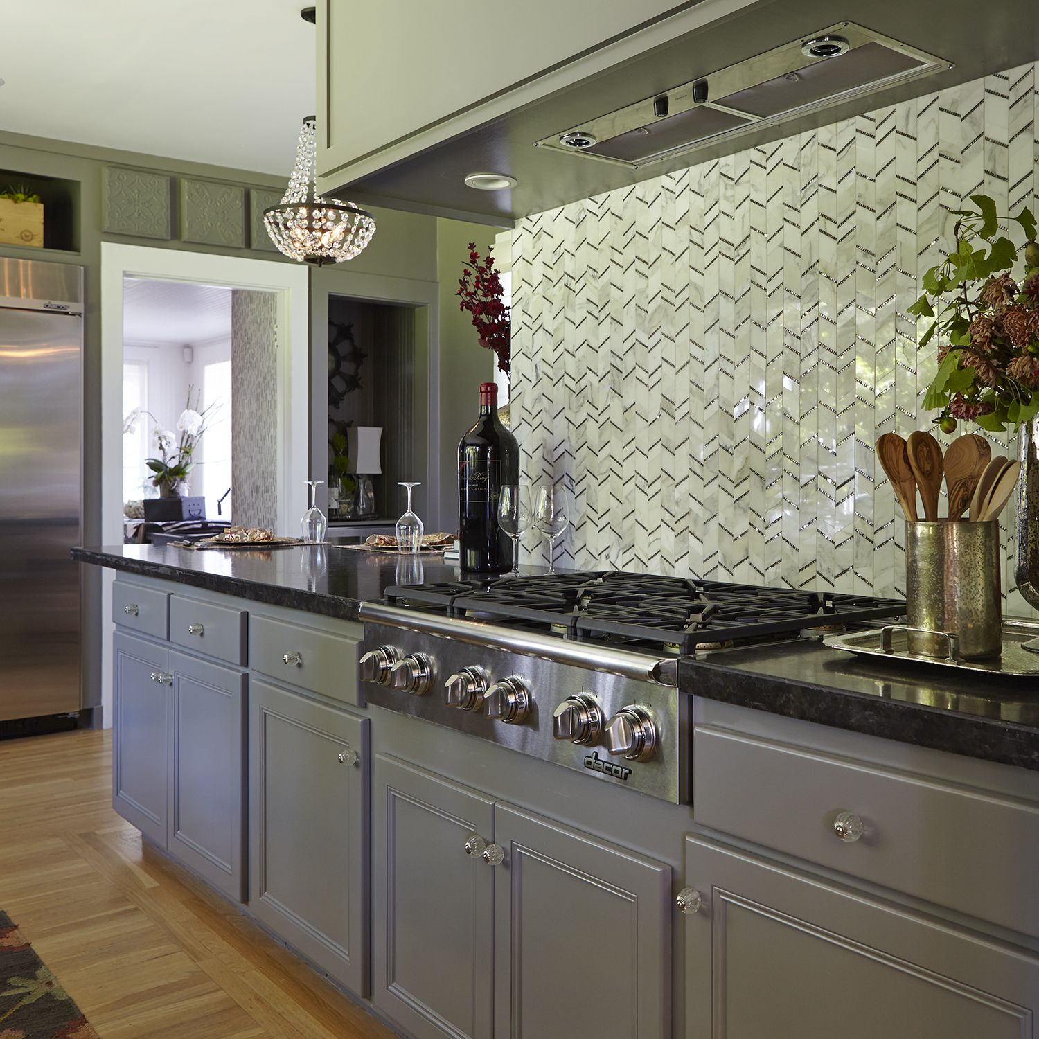 Grey Kitchen Cabinets With Black Appliances: Lovely Tiles From AKDO Form The Geometric Backsplash. The