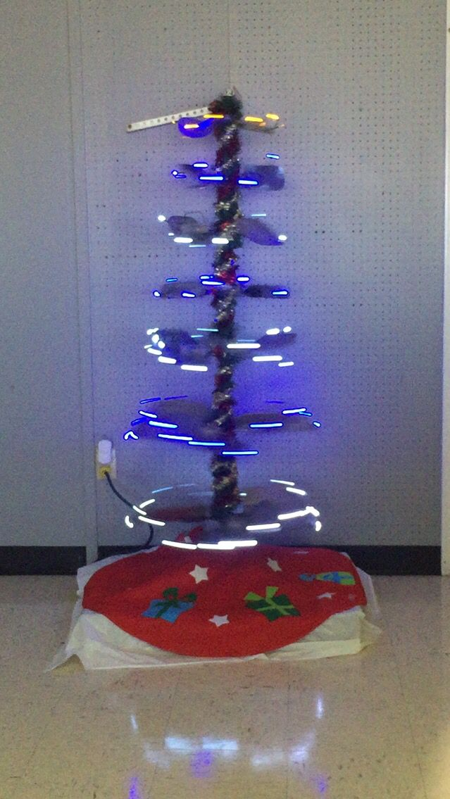 Spinning Christmas tree! HVAC fan blades and motor make a great tree.