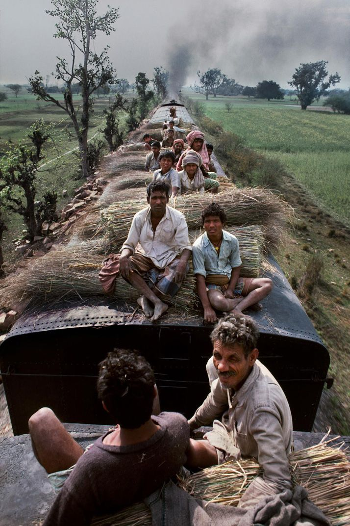 Steve McCurry photographing the swirl of life around the railroad trains in India, a vital connection between the various corners of this vast subcontinent.