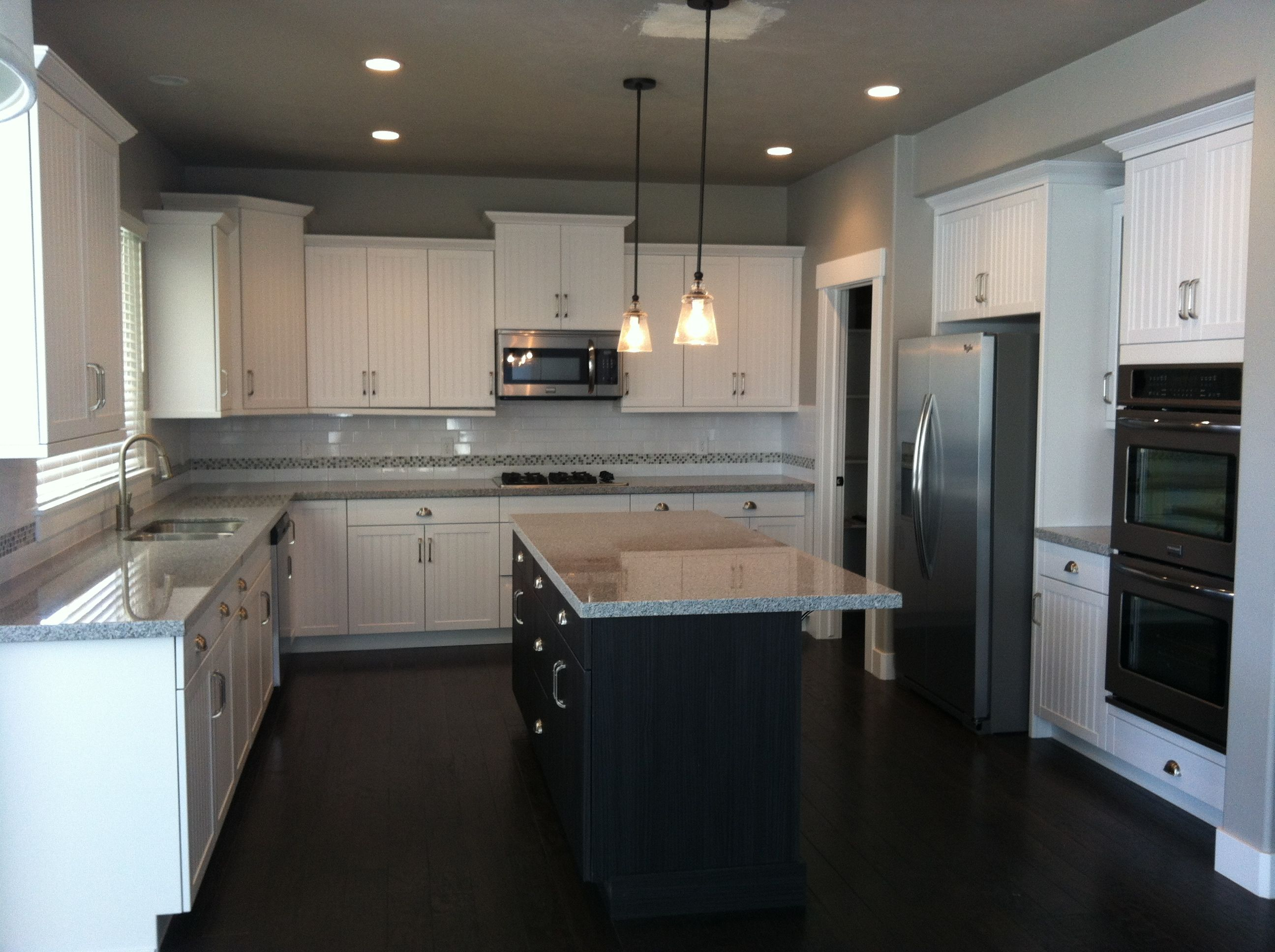 My beautiful kitchen white cottage cabinets with a dark island and