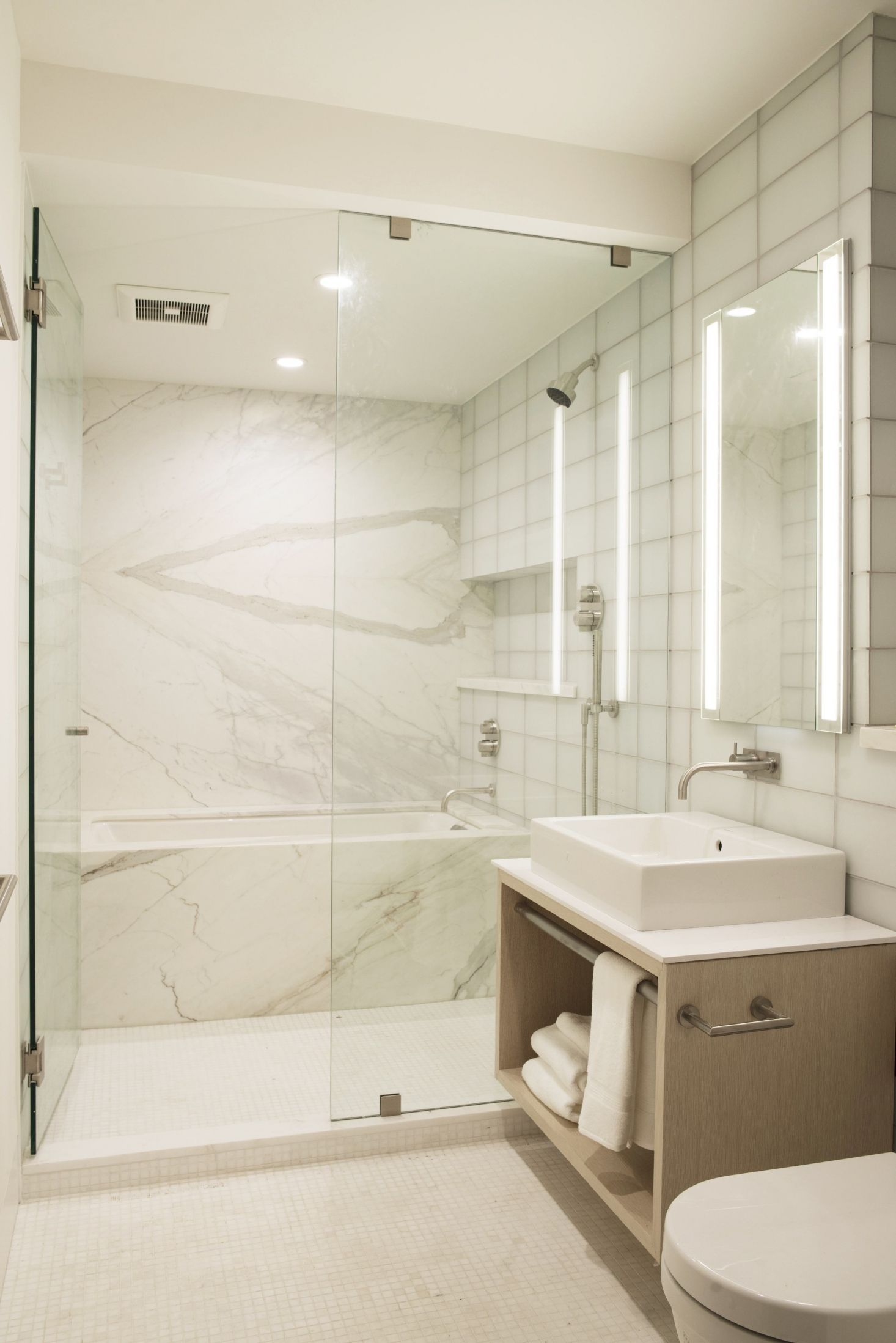 ground floor bathroom has calacatta   oro marble bathtub installed in also