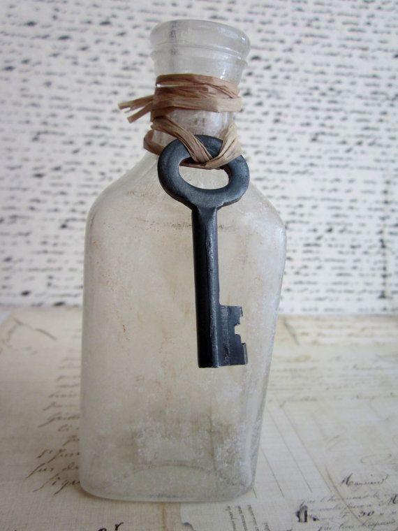 old bottle with skeleton key
