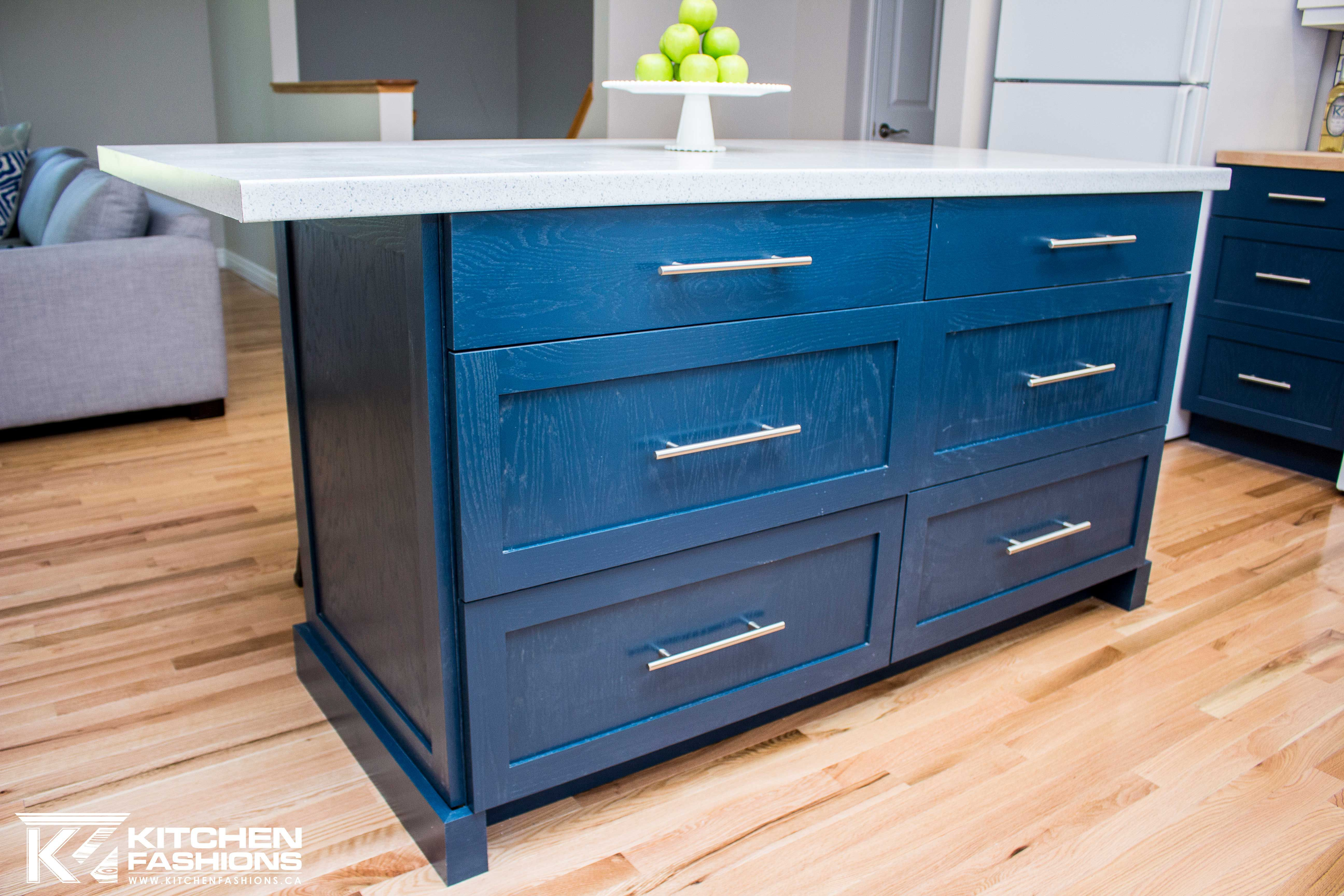 Blue Kitchen island with white countertops, silver hardware, and ...