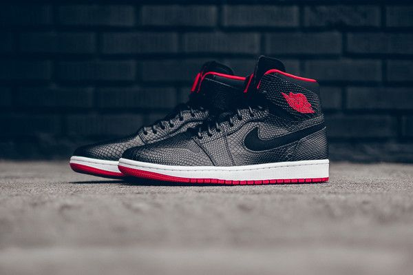 separation shoes 06f76 a41e9 The latest Air Jordan 1 High Nouveau is offered in a classic Black Gym Red  colorway defined by a snakeskin upper. Retail is set at  150.