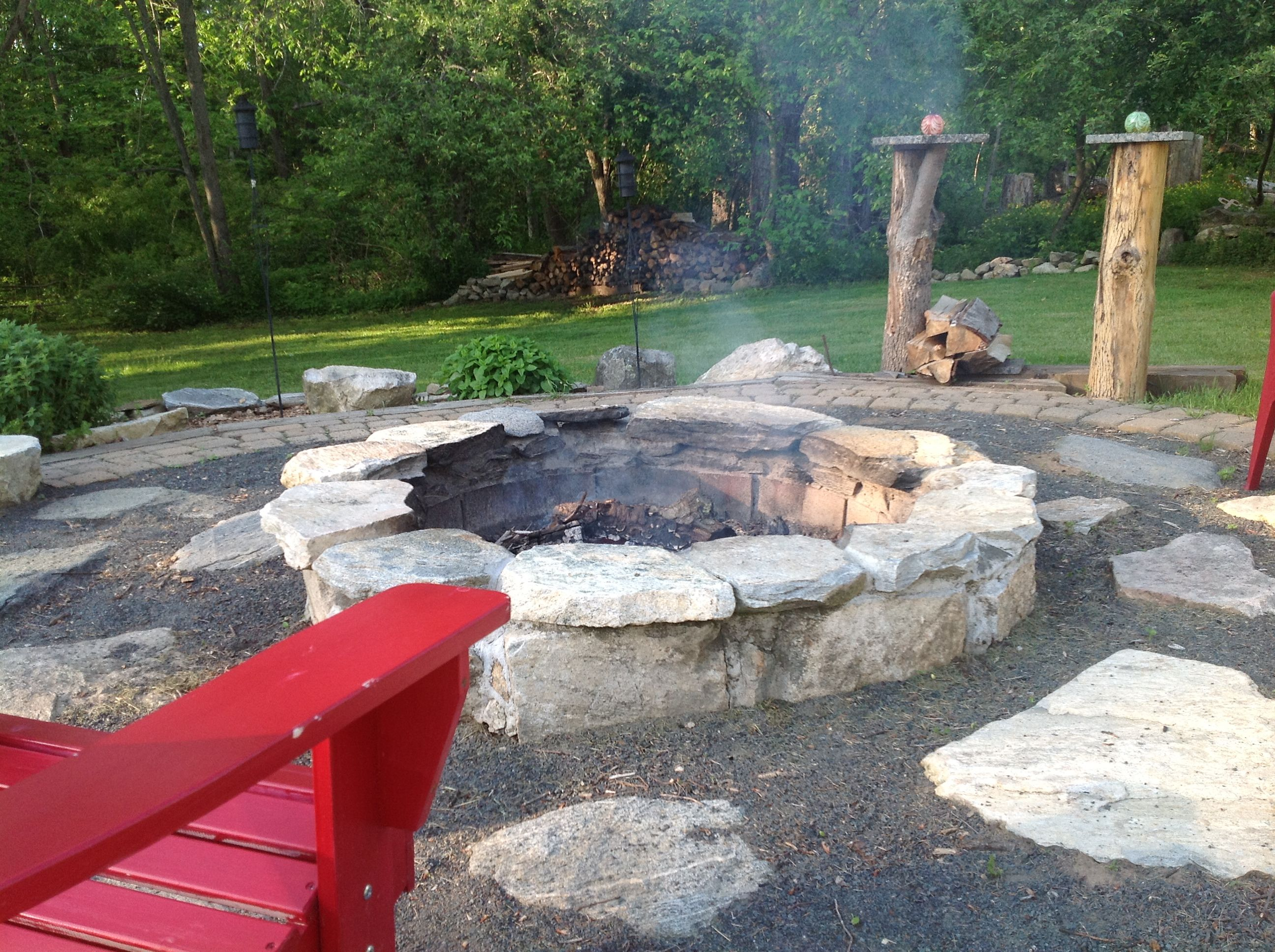 DIY fire pit...used flat rocks and square brick we already had in our back  yard.