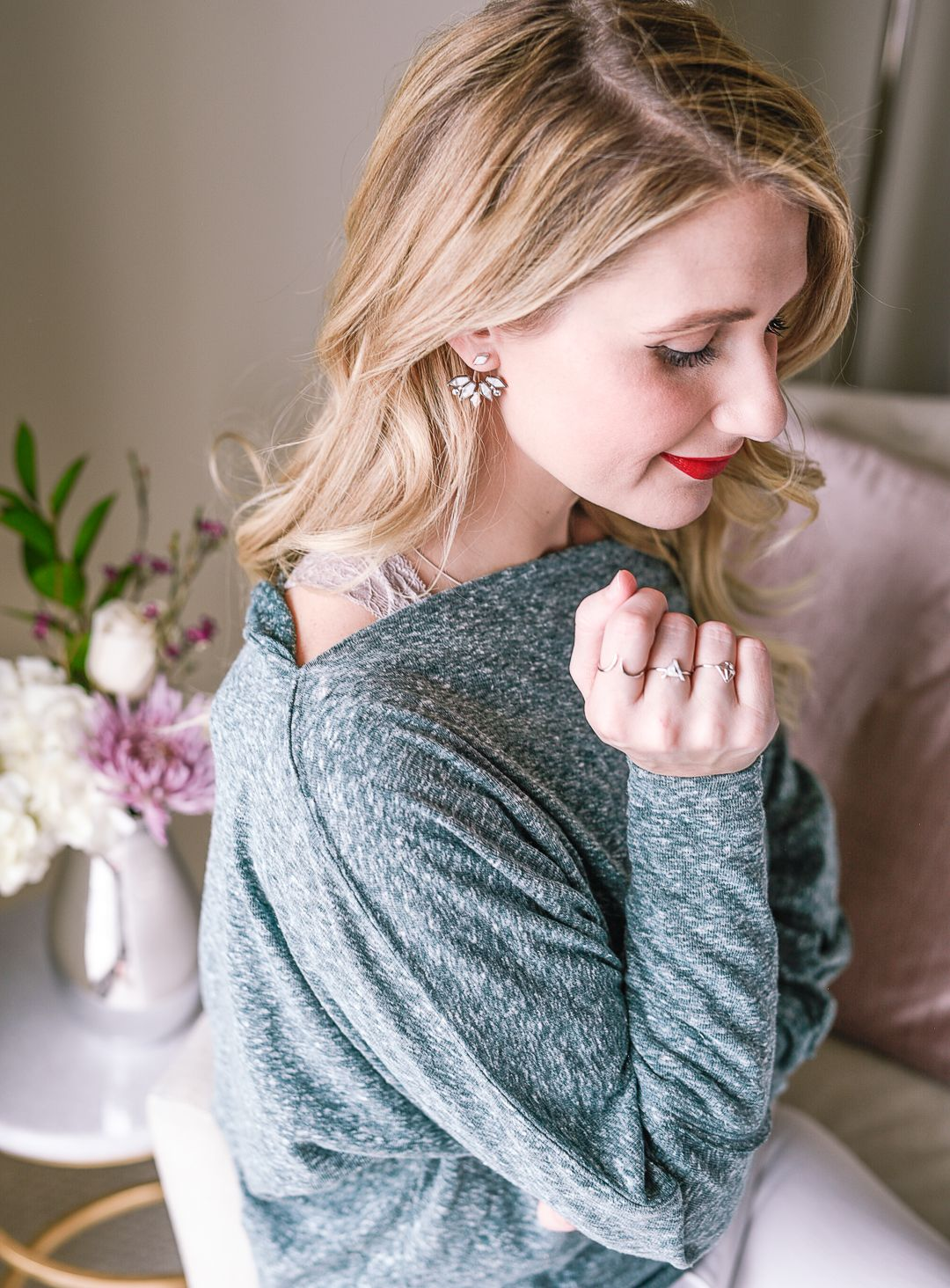 Green off the shoulder sweater.