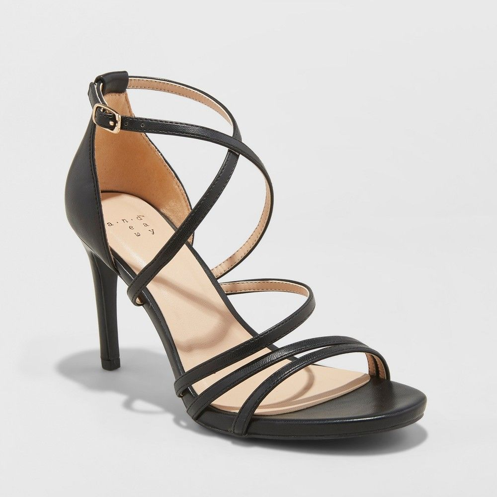 96fcdb1423 Dial up the feminine flair with these Gal Strappy Stiletto-Heeled Pumps  from A New Day. With narrow straps that wrap around the foot these strappy  stiletto ...