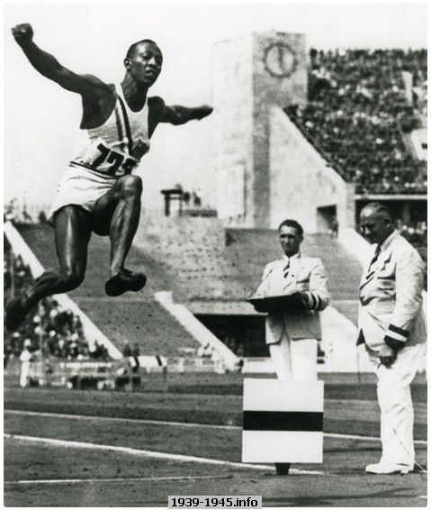 Jesse Owens winning the Gold Medal in the Long Jump competition at the 1936 Summer Olympic Games in Berlin, Germany