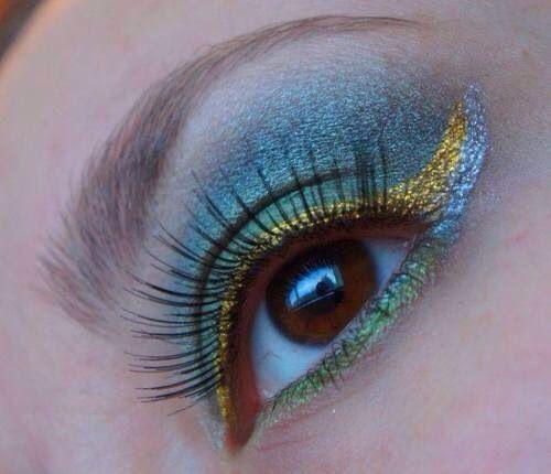 Girl with metallic blue green & gold eye shadow