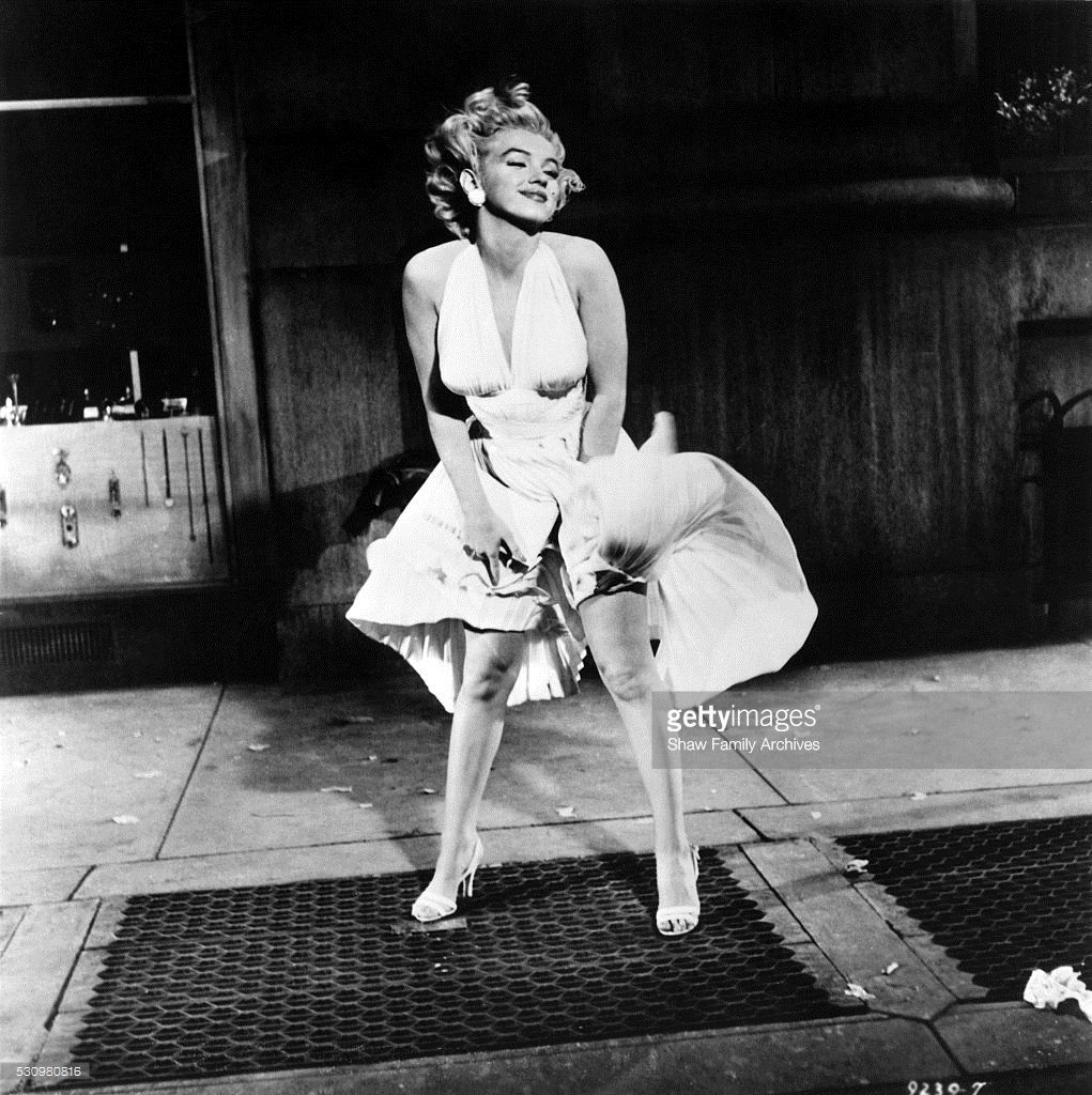 Marilyn Monroe with the skirt of her white dress blowing ...