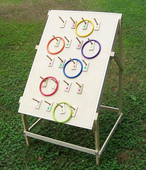 Ring toss game, ring toss, plinko, carnival game, lawn game, yard game, tailgate party, party, event game, home, school event, church is part of lawn Games Children - Ring toss has been around forever, but not like this one  This game is built for hours of fun day in and day out  Can be played indoors or out, thanks to the 6  rope rings  The pegs bolt on with wing nuts so you can add as many pegs as you want ,up to 20, for a variety of scoring options  Play games like  21 , by numbering the pegs, or add prize names and throw for prizes  The game play ideas for this ring toss are endless  Make your own rules  It can be quite challenging  This is truly a fun game to be played anywhere  This game would be great for home, birthday parties, carnivals, fairs, trade shows, tailgate parties, etc  Comes with 66  rings, 3 red and 3 blue, and colored stickers to stick on the playing surface  The frame is bolted together with wing nuts for easy setup and tear down   Just loosen the wing nuts and fold the legs up against the sides for carrying and storage and swing the legs outward and tighten the wing nuts for game play in the desired position  Playing surface approx  24  W x 36  L   The rope rings store in the back of the game for easy transport  Need a custom game  Just ask  Made of hard and soft woods  Special ads for custom orders available