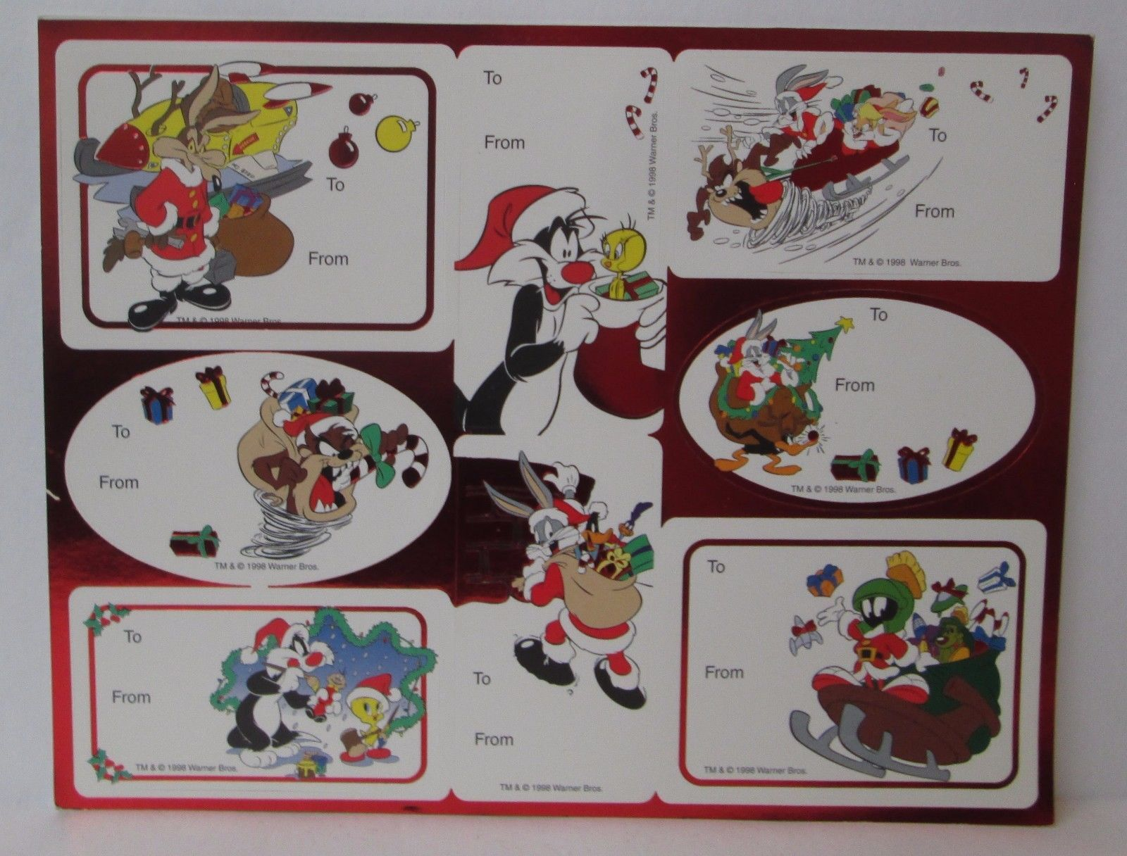 VINTAGE LOONEY TUNES CHRISTMAS GIFT TAGS STICKERS 1 Sheet 8 Tags : 5.90 ttc  ( USA)