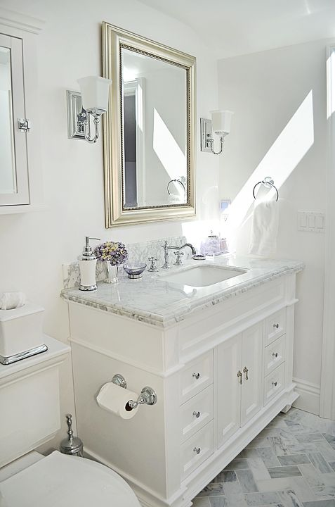 Small Bathroom With Gray Floor Tiles White Cabinet White Fixtures Bright And Clean Spa White Marble Bathrooms Bathroom Remodel Master Small White Bathrooms