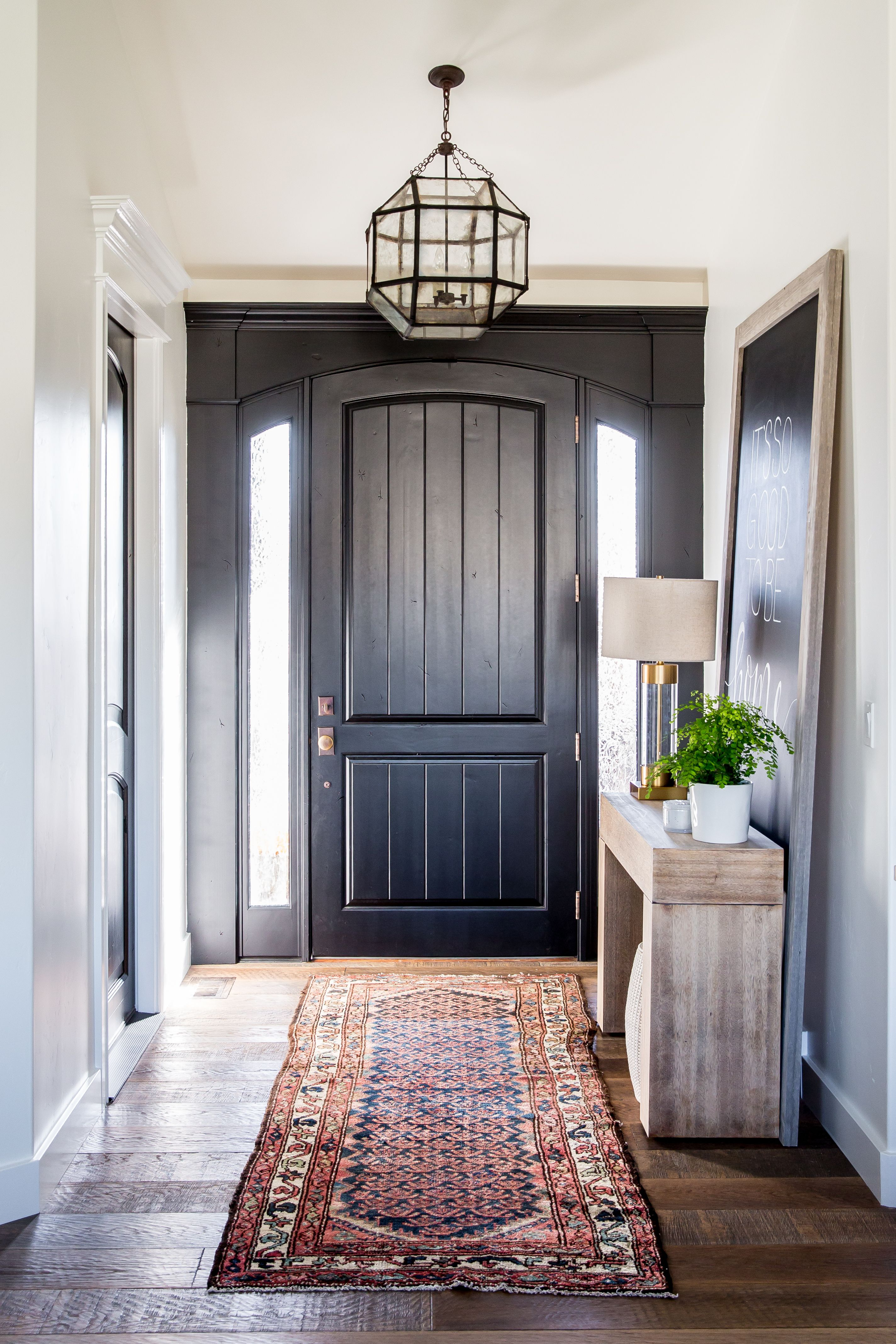 entryway with black front door and a kilim rug | interiors ...
