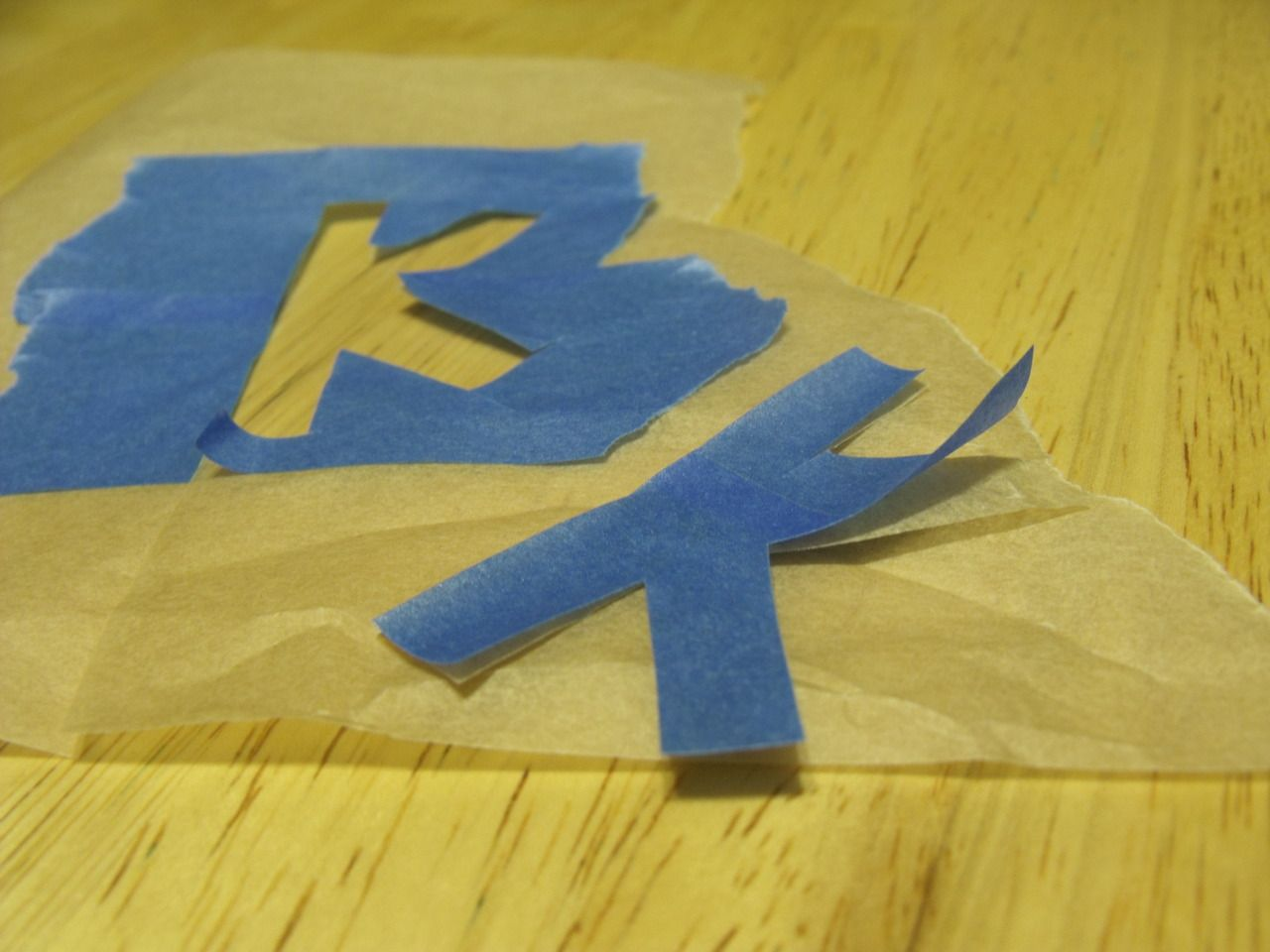 Make stencils for painting with wax/parchment paper and