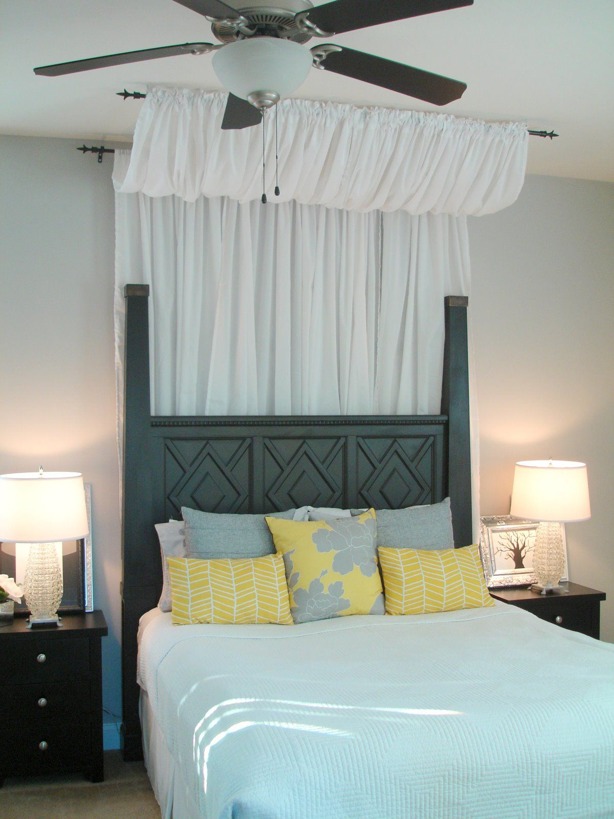 LOVE the curtain above & behind the bed!!!  Dwellings By DeVore: Easy DIY canopy for under $50. Materials: IKEA.