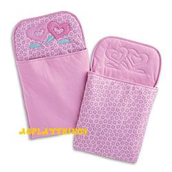 Want: 2009 Blossom Sleeping Bags for Dolls Item# F9147 $30  When the Bitty Twins sleep over at Grandma's house, they can snuggle up together in a pair of matching sleeping bags. They're fully reversible, with a blossom print on one side and solid color on the other, and they feature a heart-flower appliqué.