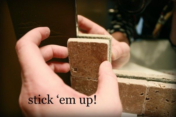 Use silicone adhesive to glue tile to the edge of raw edge mirrors. Need this for my bathroom..