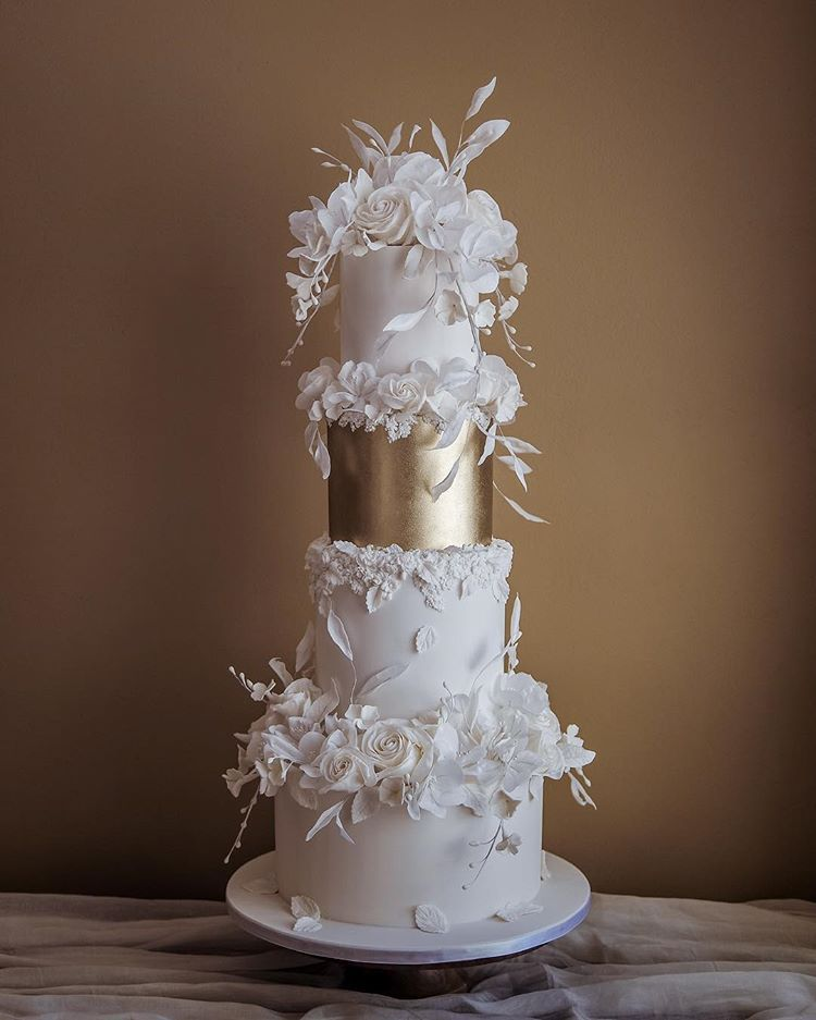 Glam white wedding cake, with a hint of bas relief texture and airy florals for our DC couple, Kezi