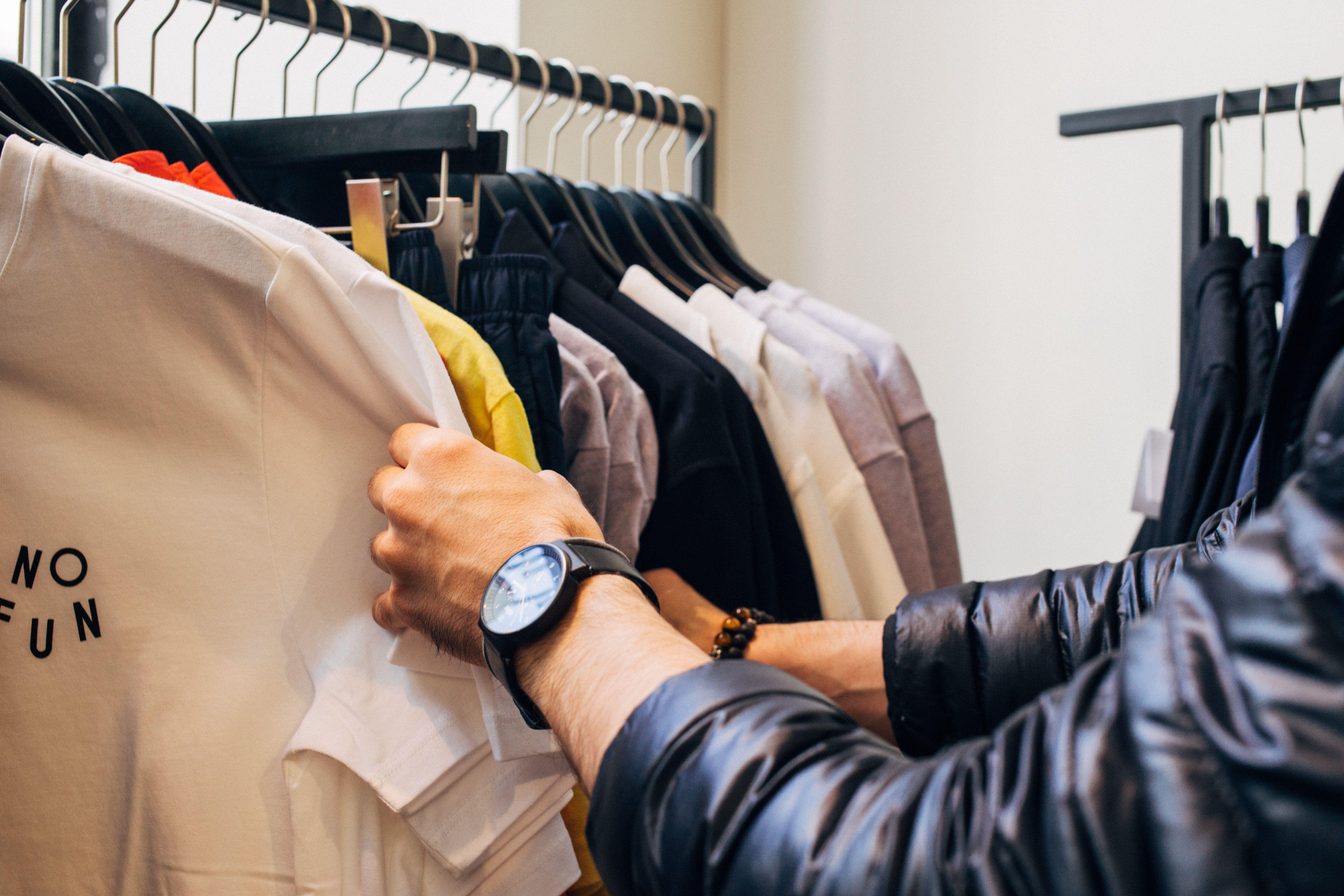 Shopping through a clothing rail
