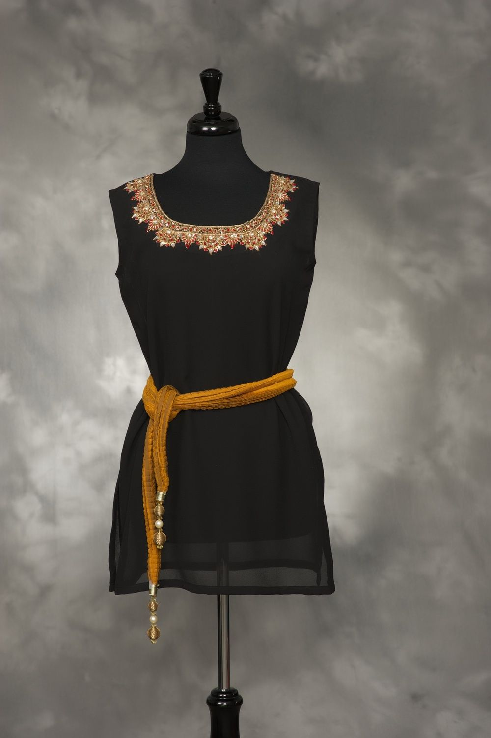 Black Georgette with gold and red embroidery and stones.