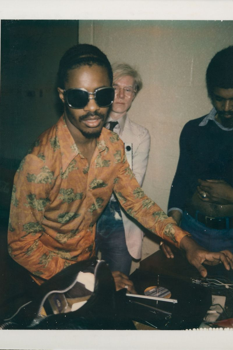 Andy Warhol and Stevie Wonder backstage at a Rolling Stones concert ...