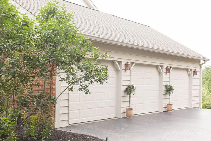 Beautiful Outdoor Lighting Perfect Between Garages Or To Frame A Front Door Outdoor Lighting House Exterior Garage Design