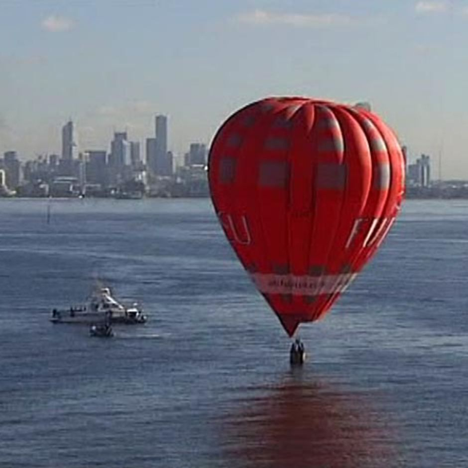 A hot air balloon floats in Port Phillip Bay off the coast of South Melbourne on January 20, 2011. The balloon first landed on the South Melbourne beach before a gust of wind blew it out to sea. Victoria, Australia