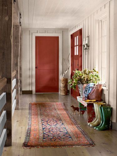 The doors are painted Red Rock by Benjamin Moore.