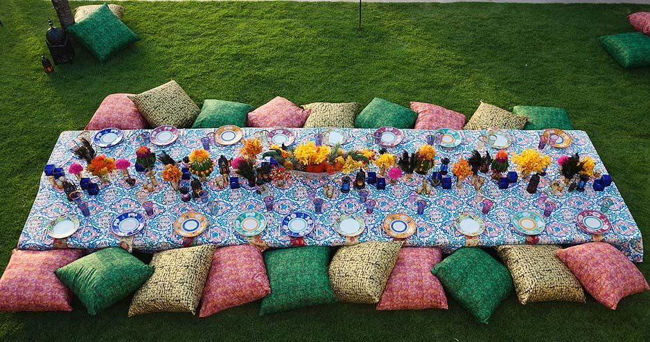 For A Moroccan Style Birthday Dinner, Bright Cushions Serve As Seating At A Low  Table Covered In Flowers.
