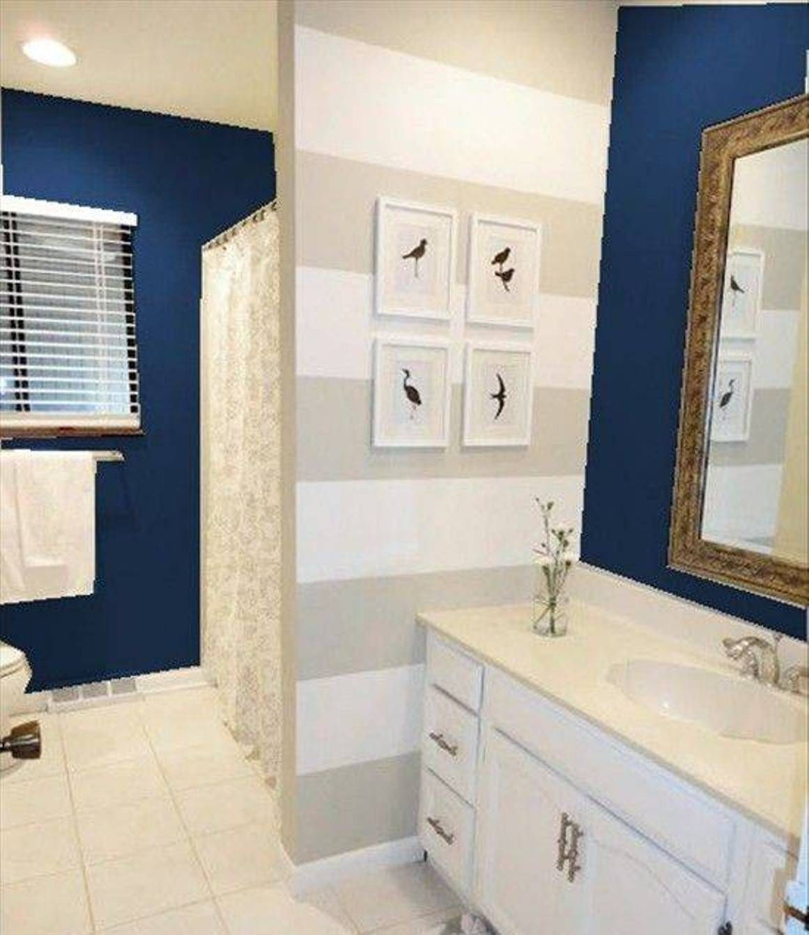 Nautical Theme Bathroom With Stripe Wall Accent And Navy Blue