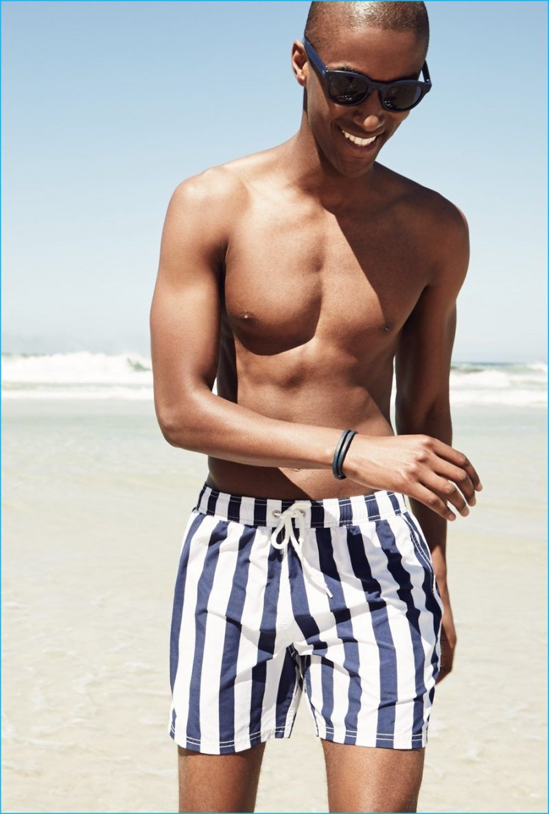 f2e9b3b409 Claudio Monteiro wears white and navy J.Crew striped swim trunks.