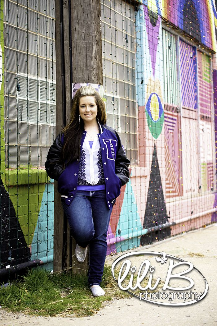 High School Senior Photography With Letter Jacket In Front Of