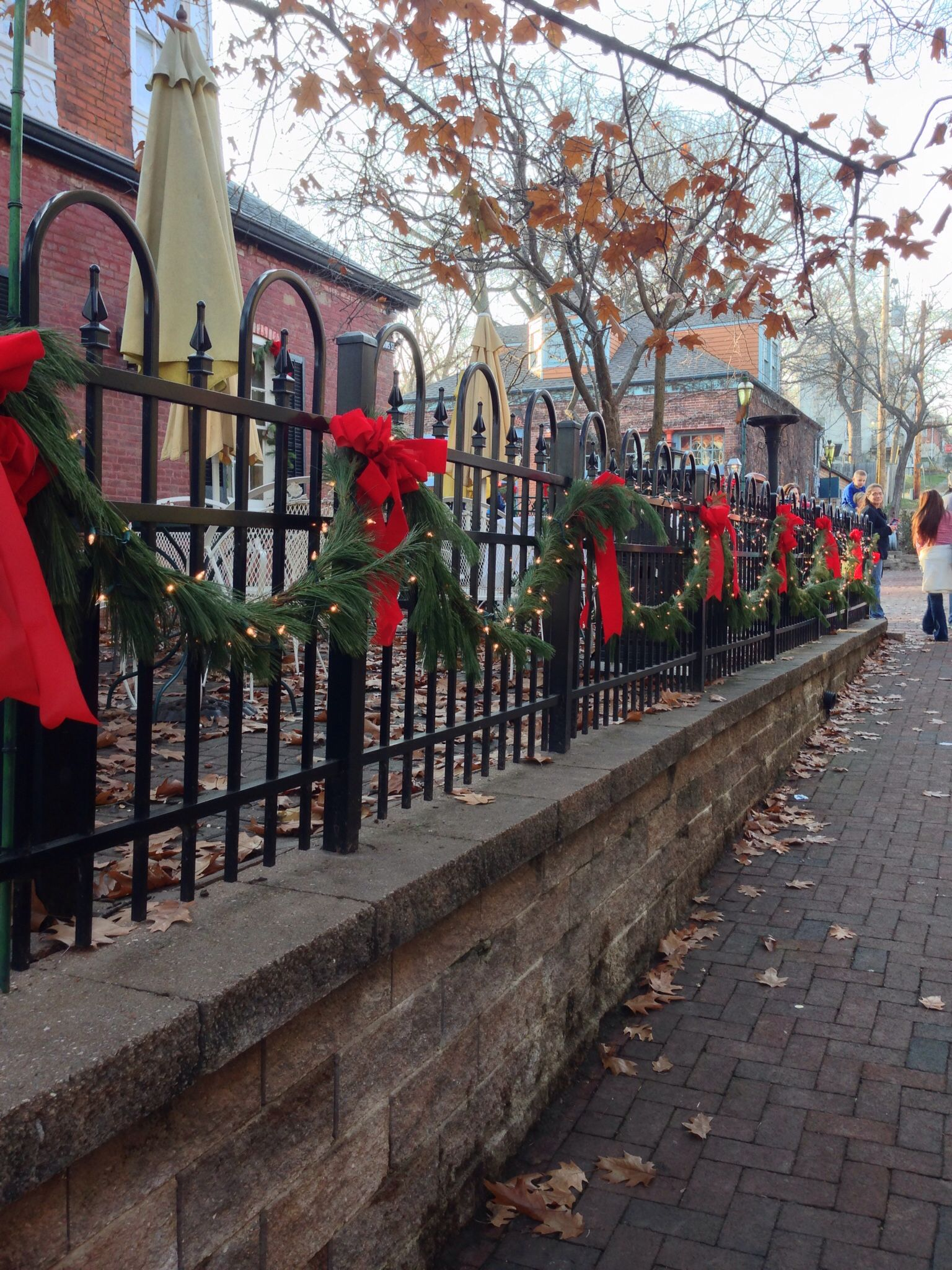 Black Wrought Iron Fence Decorated With Fresh Garland Lights Amp Red Bows Located In Old Town St