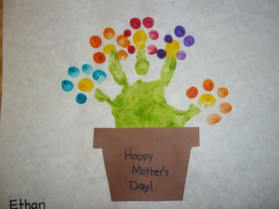 """We painted their hands green to resemble a flower and then used their finger to dot petals onto each stem."" from AnInterestingMix"