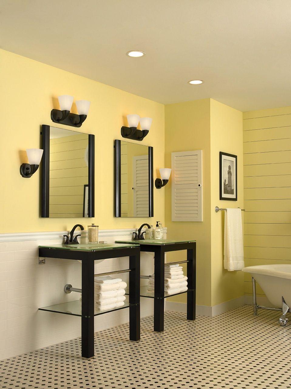 Elegant yellow bathroom design. Lighting ideas available at  https://aadenlighting.com