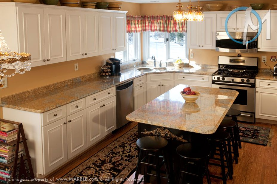 This small but open kitchen is a good example of how a granite like Juparana Wave can become the focal point of the design.